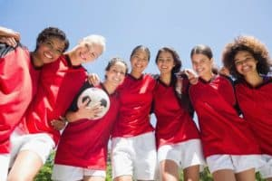 Confident young women on a soccer team.